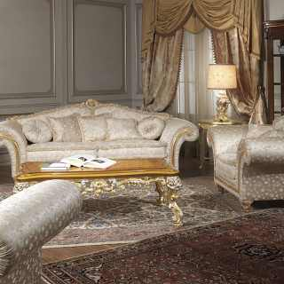 Classic living room Imperial, fabric finish, composed by a two seater sofa and two armchairs. Carved and golden details and cymatium