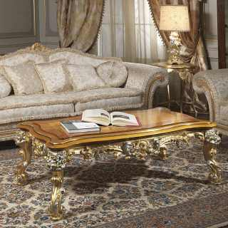Classic two seater sofa, fabric finish, with carved and golden details and cymatium. Classic table with gold and silver leaf carvings