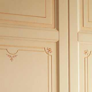 Classic modular wardrobe: detail of carvings, flower decorations and anticated finish