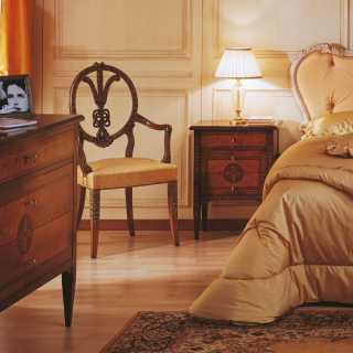 Bed with capitonné headboard, decapé walnut finish; walnut and olivewood night table and chest of drawers, antique finish; all classic luxury furniture Maggiolini collection