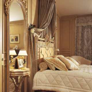 Big wall mirror with integrated night table, handmade carvings, white over gold finish as the capitonné bed