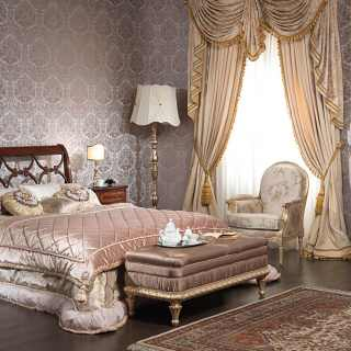 Classic bed 700 italiano style, walnut finish. Walnut night tables and chest od drawers with marquetry, golden carved wall mirror, upholstered capitonné bench