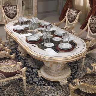 Great oval table with carved chairs Luigi XVI style from the White and Gold collection. All white over gold finish