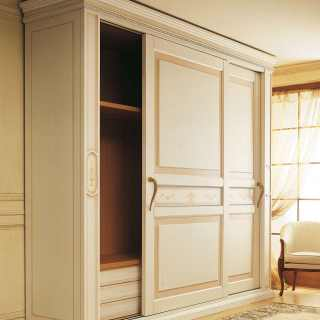 Classic wardrobe Canova with sliding doors and wooden interiors. Anticated lacquered finish