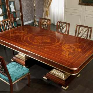 Ermitage table impero style with carvings and marquetry, carved chairs. All mahogany wood with gold leaf details
