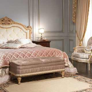 Classic luxury bedroom I Maggiolini: capitonné headboard bed, gold leaf finish, inlayed walnut night tables and chest of drawers, classic upholstered armchair and bench