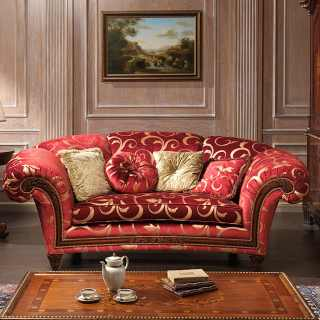 Classic living room Palace, red and gold fabric finish, composed by sofa with carved walnut details and a carved and inlayed table