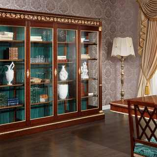 Ermitage glass showcase impero style with handmade carvings. Mahogany wood, brass decorations and gold leaf details