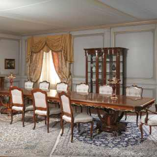 Walnut rectangular table and glass showcade, decapé finish; upholstered and carved chairs. All Luigi XV style, Parigi collection