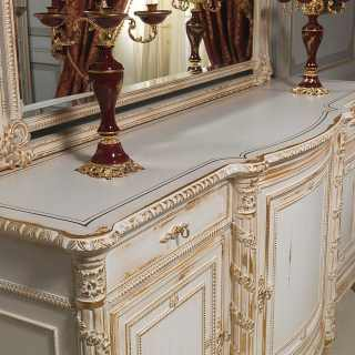 Classic luxury dining room White and Gold: wooden sideboard Luigi XVI style with mirror. All white over gold finish, handmade carvings
