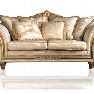 Classic sofa Imperial collection, ivory fabric finish. Carved and golden details and cymatium
