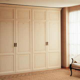 Modular classic wardrobe composed by double two doors elements with carvings, flower decorations, golden details