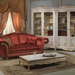 Classic living room with carved glass showcase Luigi Xv style, from classic collection Venezia. Carved table white over gold, carved Imperial sofa